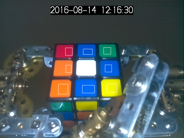The photo of the cube with marked regions for color recognition